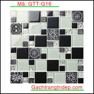 Tên sản phẩm Gạch Mosaic trang trí Mã sản phẩm GTT-G5 Số vỉ/ hộp 22 Kích thước vỉ 300x300mm Số vỉ/ m2 11 Giới thiệu về gạch mosaic nói chung và gạch mosaic gốm nói riêng: Việc sử dụng gạch mosaic để trang trí đã xuất hiện ở châu Âu vào thời kỳ cổ xưa, chúng ta có thể thấy chúng ở các công trình kiến trúc như lâu đài, nhà thờ. Ngày nay, cùng với sự phát triển của khoa học và kỹ thuật, nhu cầu về trang trí nội ngoại thất ngày càng tăng cao người ta ngày càng sử dụng gạch mosaic để trang trí nhiều hơn. Để đáp ứng nhu cầu đó trong những năm gần đây gạch mosaic đã không ngừng phát triển. Cấu tạo của một tấm gạch mosaic thường gồm 3 lớp: Lớp dưới cùng là chứa sợi thủy tinh hoặc kafl dùng để kết dính các mảnh gạch với nhau. Lớp ở giữa : là lớp keo liên kết giữa vật liệu và lớp giấy. Lớp trên cùng là lớp vật liệu mosaic: Có thể là gạch mosaic gốm, đá tự nhiên hoặc thủy tinh. Căn cứ vào lớp trên của gạch mosaic mà ta phân loại thành các loại gạch mosaic sau đây: _ Gạch mosaic gốm: Có lớp bề mặt trên khảm gốm, men tiện lợi trong việc làm gạch lát nền nhà, dán trang trí tường. _ Gạch mosaic thủy tinh: Có lớp bề mặt trên khảm thủy tinh, hiện đại, chống ẩm và chống thấm nước cực kỳ tốt. _ Gạch mosaic đá tự nhiên: Có lớp gạch trên khảm đá trong suốt, tiện lợi để làm gạch lát sàn sân vườn.